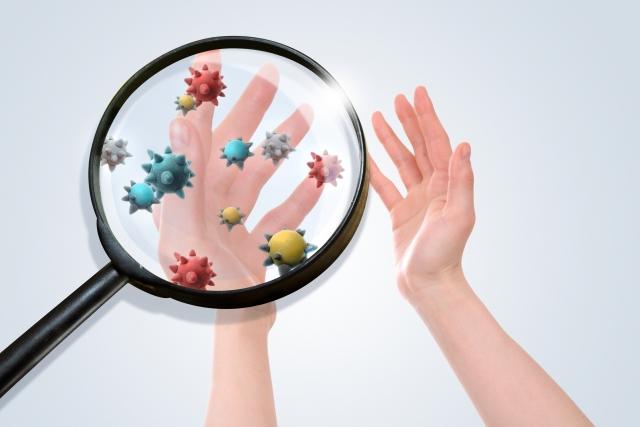 ウィルスや菌がついた手のイメージ